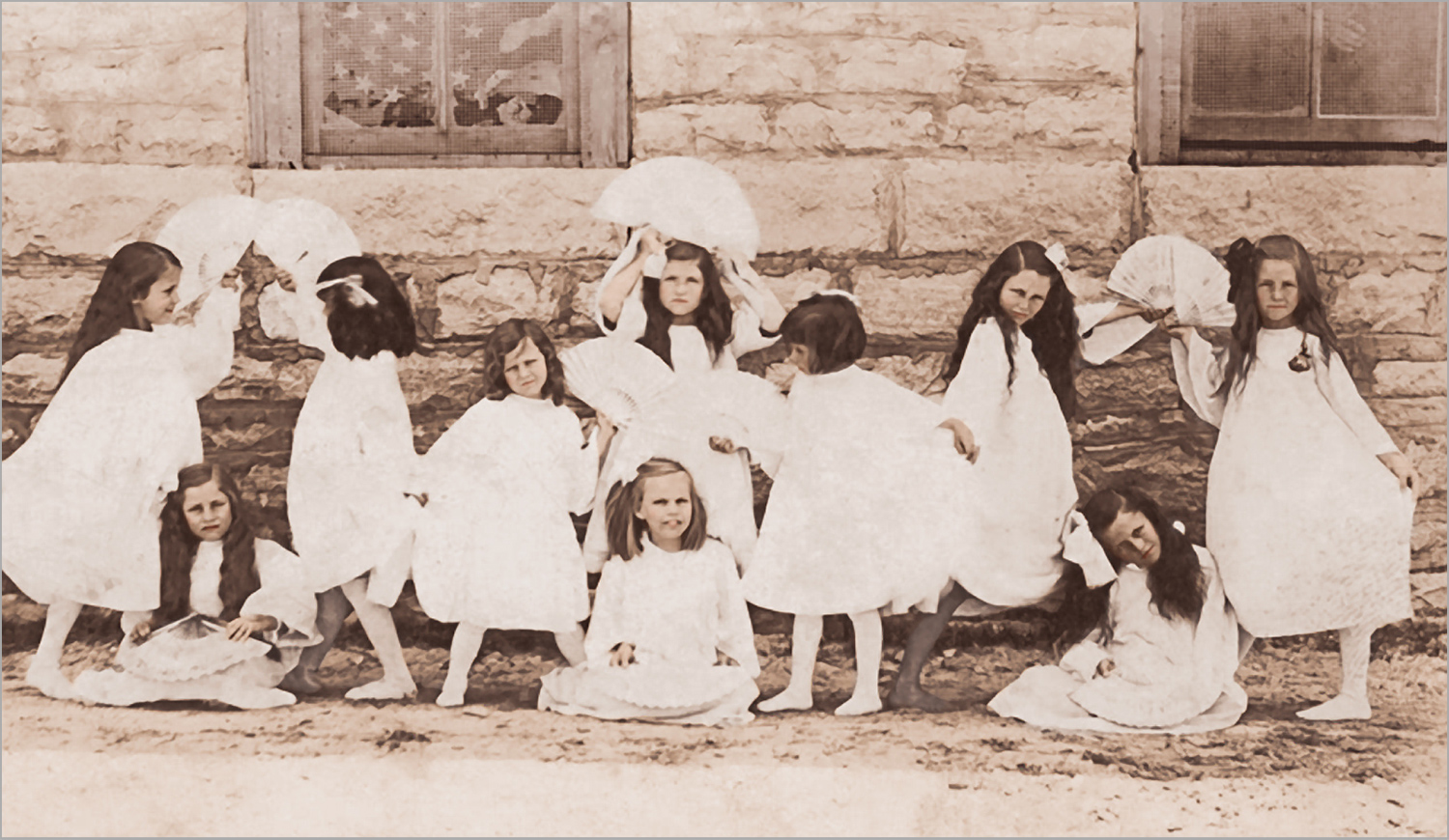 dancing children in white dresses