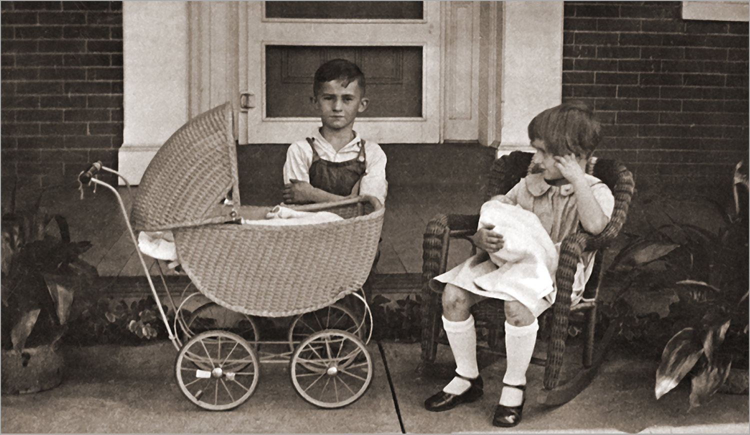 children with doll and baby carriage