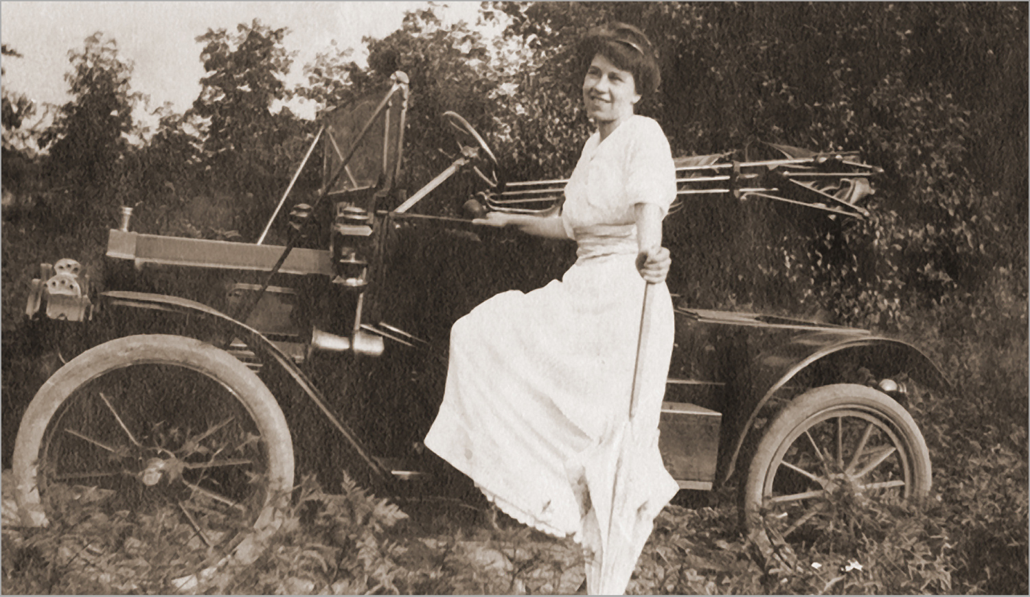 posing by the Model-T